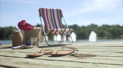 A sun chair on a jetty, Sweden. Stock Footage