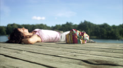 A woman on a jetty by a lake, Sweden. Stock Footage