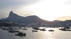 Boats moored on harbor near Corcovado Mountain Stock Footage