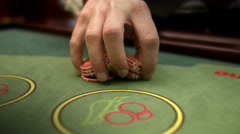 A croupier with gambling chips at a gambling table. Stock Footage