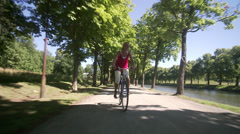 A woman riding a bike, Sweden. Stock Footage