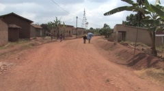 Few people are walking on road in one of the poorest states in Africa, Rwanda Stock Footage