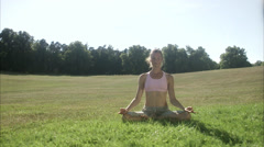 A woman doing yoga in a park outside, Sweden. Stock Footage