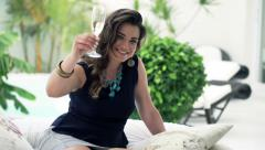 Portrait of happy, flirting woman raising toast to camera on bed on patio HD Stock Footage