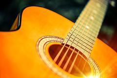 Acoustic Wooden Guitar Closeup Photo. - stock photo