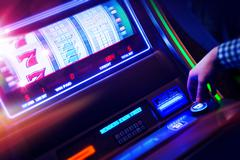 Casino Slot Machine Player Closeup Photo. Stock Photos