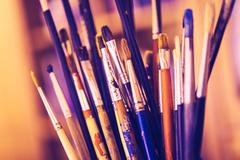 Dirty Colorful Oil Paintbrushes Closeup Photo. Stock Photos