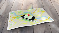 Red marker pointing at a mobile lying on a map of a town Stock Footage
