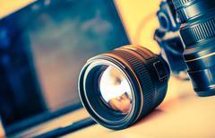 Photographer Desk with Lenses - stock photo