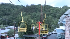 4K. Girl Tourist Kicks Her Legs While Riding Skylift - stock footage