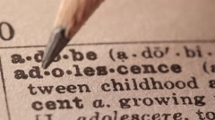 Adolescence - Fake dictionary definition of the word with pencil underline - stock footage