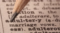 Adultery - Fake dictionary definition of the word with pencil underline Stock Footage
