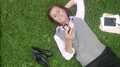 A woman in a park using her mobile phone, Sweden. Stock Footage