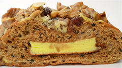 Healthy and yummy bread with walnut raisin and melon seed rotating on white Stock Footage