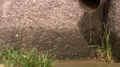 Rain drops from a drainpipe, close-up. Stock Footage
