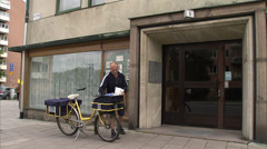 A postman on a bicycle, Stockholm, Sweden. Stock Footage