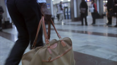 A businessman carrying a bag at a train station, Stockholm, Sweden. Stock Footage