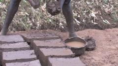 Making Mud Bricks in Rural African Village Stock Footage