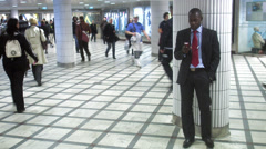 A businessman at a train station, Stockholm, Sweden. Stock Footage
