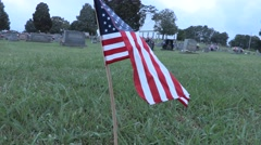 4K American Flag in Cemetery Lawn - stock footage