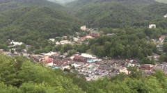 Aerial View of town surrounded by Appalachian Mountains  Stock Footage