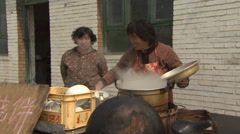 Rural China Women cooking outisde lunch house Stock Footage
