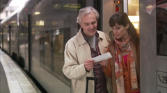 A middle aged couple holding a train ticket, Sweden. Stock Footage