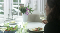 Grandmother, mother and daughter at dinner table, Sweden. Stock Footage