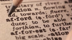 Afford - Fake dictionary definition of the word with pencil underline Stock Footage