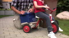 Granddaughter and grandfather recycling cans, Sweden. Stock Footage