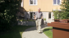 Man recycling newspapers, Sweden. Stock Footage