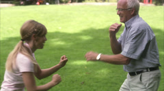 A woman and an elderly man pretending to fight, Sweden. Stock Footage