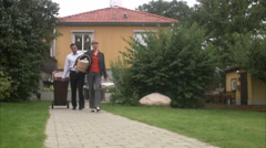 Man and woman taking out the garbage for recycling, Sweden. Stock Footage