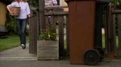 A couple recycling newspapers, Sweden. Stock Footage
