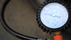 Car wheel add air pressure. Pump pumps Stock Footage