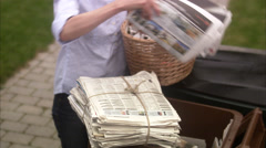 A woman recycling newspapers, Sweden. Stock Footage