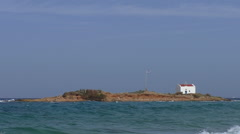 Greek flag and church on remote island - stock footage