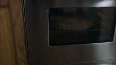 Man taking a pie out of the oven, Sweden. Stock Footage