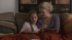Mother and daughter reading a newspaper together, Sweden. Arkistovideo
