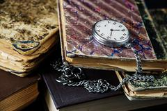 Old books and  pocket watch - stock photo