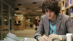 Male pensive student in a library, Sweden. Stock Footage