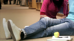 Students in a library listening to music, Sweden. Stock Footage