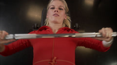 A woman weight training at a gym, Sweden. Stock Footage