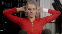 A woman doing sit-ups at a gym, Sweden. Stock Footage