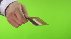 Hand holding out a credit card. - stock footage