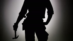 The silhouette of a construction worker. Stock Footage