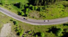 Aerial view of  truck on green hills Stock Footage