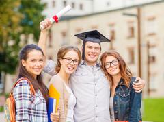 Students or teenagers with files and diploma Stock Photos