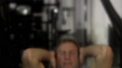 A man doing sit-ups at a gym, Sweden. Stock Footage