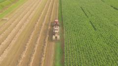 Tractor Baling Hay Aerial 4k Stock Footage
